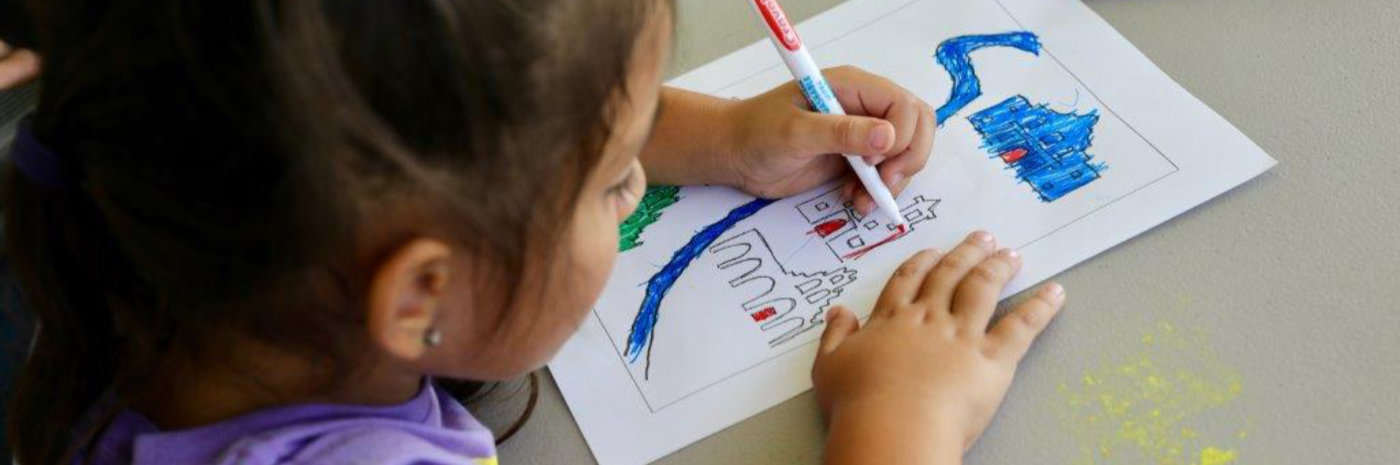 Photo of little girl coloring picture of Missions